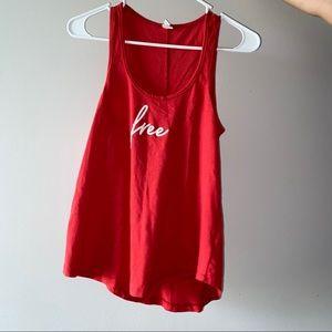 women's red sleeveless shirt.